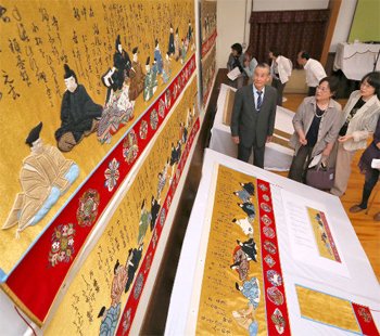 "The newly renovated, gorgeously re-embroidered ""Mizuhiki"" of the Urade Yama featuring ""Thirty-six Immortal Poets"" (Foundation for Gion Festival Preservation Associations)"