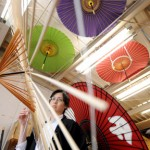 "Photo= The studio with colorful, hand-made ""wagasa"" hung from the ceiling (Hiyoshiya, Kamigyo Ward, Kyoto)"