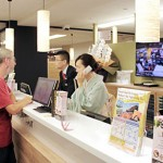 Photo= The tourist information center for foreigners established by Keihan Electric Railway Co., Ltd. and JTB Western Japan, Corp. Immediately after opening, users came by one after the other. (Kyoto Tower, Shimogyo Ward, Kyoto)