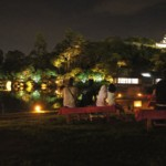 Photo= Visitors listen to the refreshingly cool sounds of insects in the lit-up garden (Genkyu-en, Konkicho, Hikone City, Shiga Prefecture)