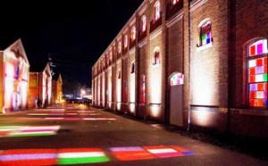 "Photo= Red, green and blue light spills out of the windows during the lighting test for ""Maizuru Akarenga Stained Glass"" (Maizuru Brick Park, Kitasui, Maizuru City, Kyoto Prefecture)"