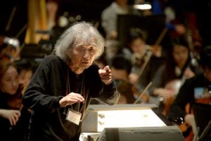 Photo= Seiji Ozawa gives directions at the stage rehearsal