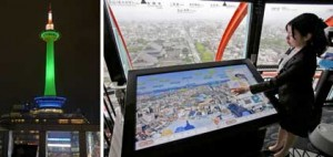 Photo= The touch-screen tourist information monitor newly installed on the observation deck. Viewers can get information right at hand while observing the ancient capital from above (Kyoto Tower, Shimogyo Ward, Kyoto) = right. The tower's illumination can be switched to a wide variety of colors through LEDs.