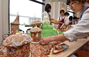 Students making candy houses with cookies and marzipan