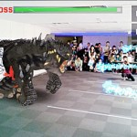 Photo= An image of the attraction in which players can battle against a virtual monster using special techniques