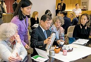 Photo= Parisians learning how to make Gyokuro tea from Chotaro Horii, president of Kyoto Tea Cooperative (middle) = November 24, Paris, France