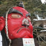 "Photo= ""Tengu"" statue whose nose was broken under the weight of the snow in front of Eizan Electric Railway's Kurama Station"