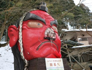 """Photo= """"Tengu"""" statue whose nose was broken under the weight of the snow in front of Eizan Electric Railway's Kurama Station"""