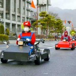 Photo= Aiming for their commercialization, go-karts run through Otsu City (in front of City Hall, Goryo-cho, Otsu City, Shiga Prefecture)