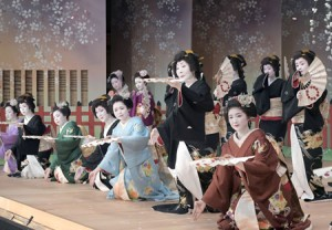 "Photo= Ornately costumed, all the geisha and apprentice geisha appear in the finale ""Kamishichiken Yakyoku"" (March 24, Kamishichiken Kaburenjo Theater, Kamigyo Ward, Kyoto)"