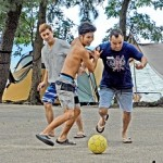 Photo= Brazilian campers enjoy playing soccer with Japanese (Maiami Auto Camp, Yoshikawa, Yasu City, Shiga Prefecture)