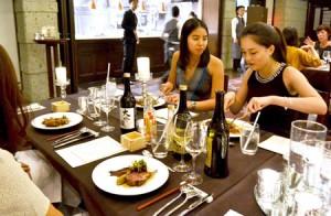 Photo= Participants enjoying a combination of Japanese sake and Western-style cuisine (Higashiyama Ward, Kyoto)