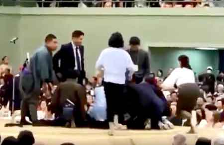 "Photo= An image uploaded to the online video platform ""YouTube"" on April 4. Some women were in the ring providing life-saving measures to Ryozo Tatami, mayor of Maizuru City, who collapsed."