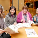 Photo= Paruyon members talk while holding their newly printed guidebook (Kamigyo Ward, Kyoto)