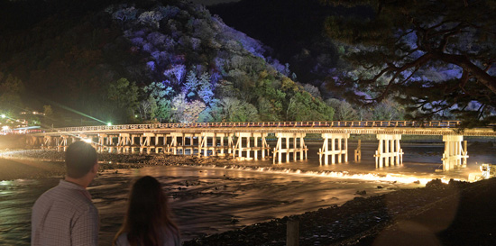 The illuminated Togetsu-kyo Bridge emerges during a lighting test (7:10 p.m., December 6, Ukyo Ward, Kyoto)