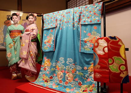"Kyo-Yuzen dyed kimono reproduced from the attire of previous Minamiza performances and redesigned in a modern style. Geiko and Maiko will wear the kimono with a Nishijin brocade belt in the dancers' collective performance during ""Miyako Odori"" (Higashiyama Ward, Kyoto)"