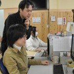 Kyoto Animation staff checking finished work (April, 2009, Kyoto Animation studio, Fushimi Ward, Kyoto)