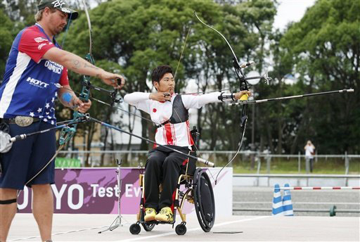 Tomohiro Ueyama (R) competes against Brady Ellis at an archery test event for the Tokyo 2020 Olympics