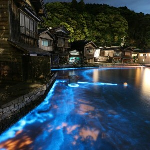 Long-exposure photo taken on May 12, 2021, shows blue water by the surf at Ine Bay in Ine, Kyoto Prefecture.